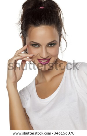 happy young woman with a seductive look on a white background