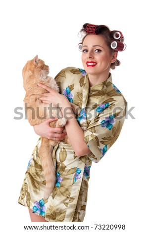 Happy young woman with a yellow cat on a white background. - stock photo