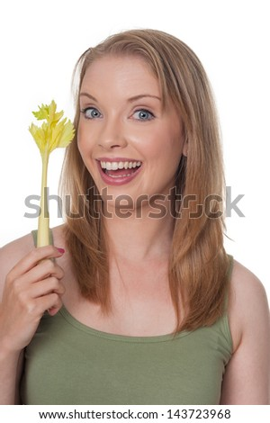 Happy young woman with celery stick - isolated on white