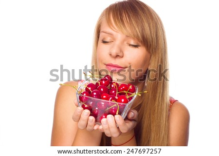 Happy young woman with cherries