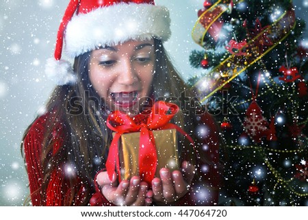 Happy young woman with christmas box gift