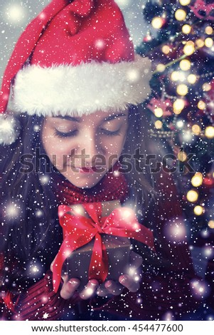 Happy young woman with christmas box gift - stock photo
