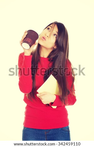 Happy young woman with coffee and notebook. - stock photo