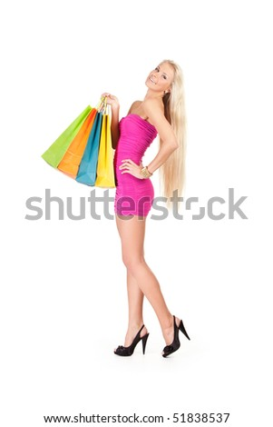 happy young woman with colorful shopping bags - stock photo