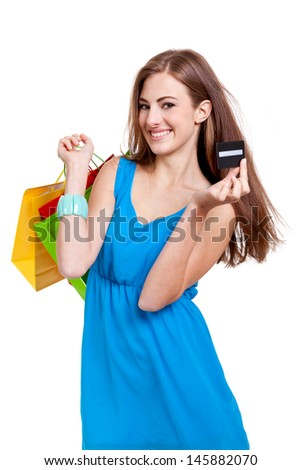 happy young woman with colorful shopping bags visa credit card isolated - stock photo