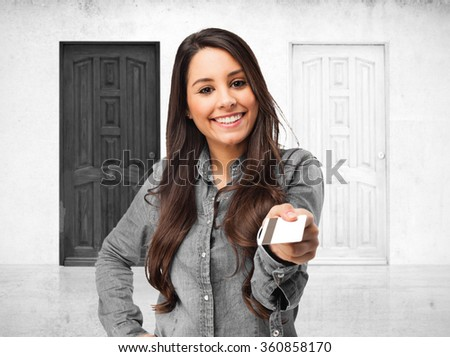 happy young woman with credit card - stock photo