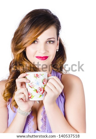Happy young woman with cup of tea or coffee, white background - stock photo