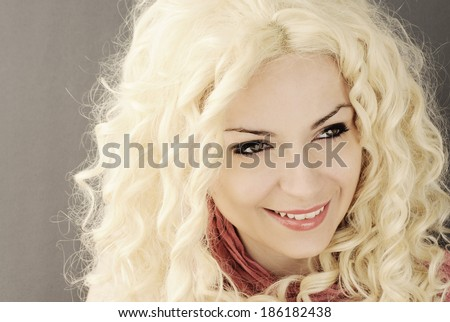 Happy young woman with curly platinum blond hair - stock photo
