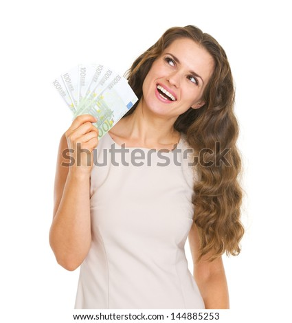 Happy young woman with euros looking up on copy space