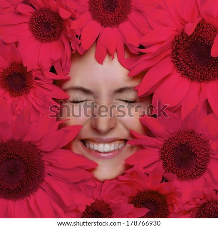 Happy young woman with flowers. Woman face and pink flowers - stock photo