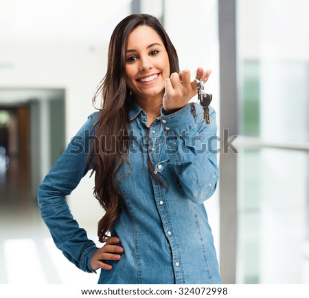 happy young woman with keys - stock photo