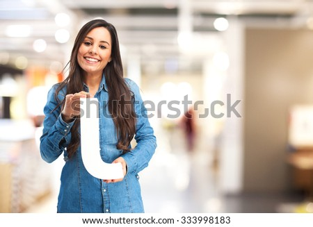 happy young woman with letter j