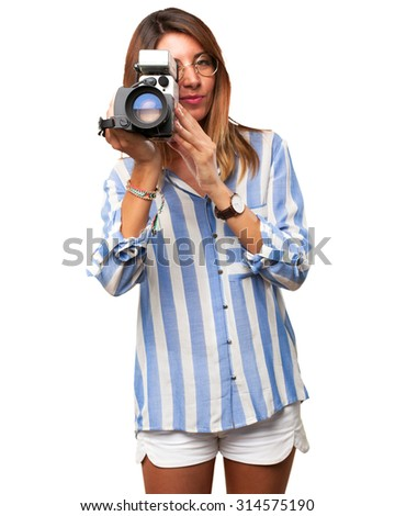 happy young woman with movie camera