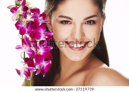 happy young woman with orchid on white background
