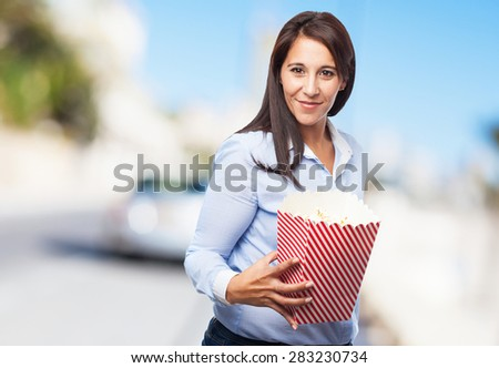 happy young woman with popcorn