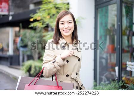 happy young woman with shopping bags - stock photo