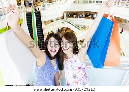 Happy young  woman with shopping bags at the mall  - stock photo