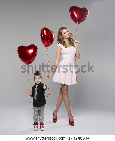 Happy young woman with small cute boy