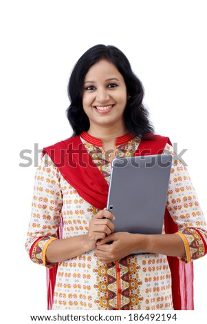 Happy young woman with tablet against white background - stock photo