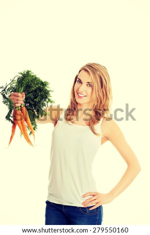 Happy young woman with the carrots
