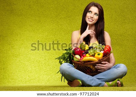 Happy young woman with vegetables.