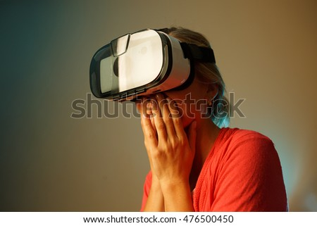 happy young woman with virtual reality headset or 3d glasses