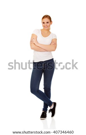 Happy young woman wiyh folded arms - stock photo