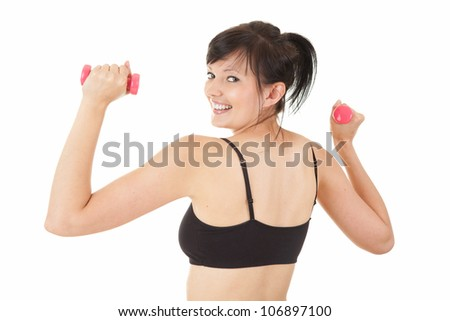 happy young woman working out in the gym with small dumbbells, white background