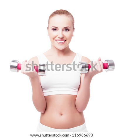 happy young woman working out with dumbbells, isolated on white background