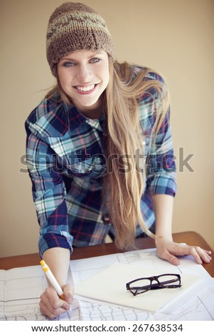 Happy young woman working, relaxed  - stock photo