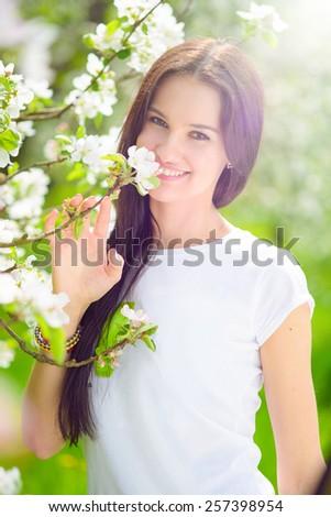 happy young women in the garden - stock photo