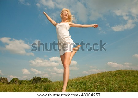 Happy young women running in field - stock photo