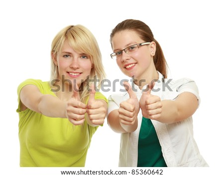 Happy young women showing thumbs up isolated - stock photo