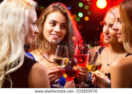 Happy young women with glasses of champagne. Xmas - stock photo