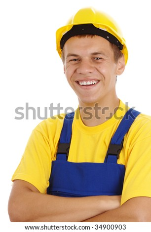 Happy young worker fold his arms, dressed in blue-and-yellow uniform and hard hat, isolated over white - stock photo