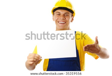 Happy young worker showing blank message and smile, isolated over white - stock photo
