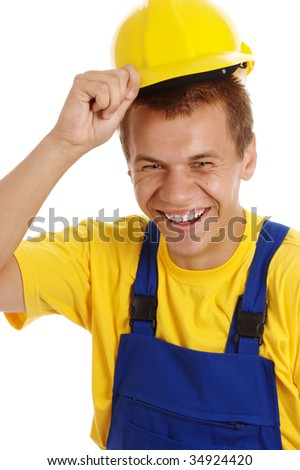 Happy young worker taking off his yellow hard hat and smile, isolated over white - stock photo