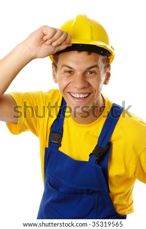 Happy young worker taking off his yellow hard hat and smile, isolated over white