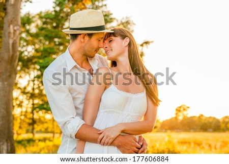 happy younger adults embracing and kissing