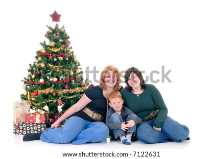happy youngsters, teenage girls and one boy around Xmas, Christmas three with presents, gifts.  White background.