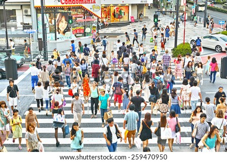 HARAJUKU, TOKYO - JULY 26, 2014: Pedestrian crossing in the corner of La Foret Harajuku fashion building and Tokyu Plaza shopping complex in Omotesando and Harajuku area, downtown Tokyo. - stock photo