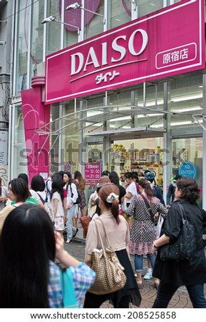 HARAJUKU, TOKYO - JUNE 29, 2014: DAISO 100 YEN Shop in Takeshita Street which is a pedestrian street with many fashion boutiques and groceries. 100 YEN shop offers all goods with 100 Japanese Yen. - stock photo