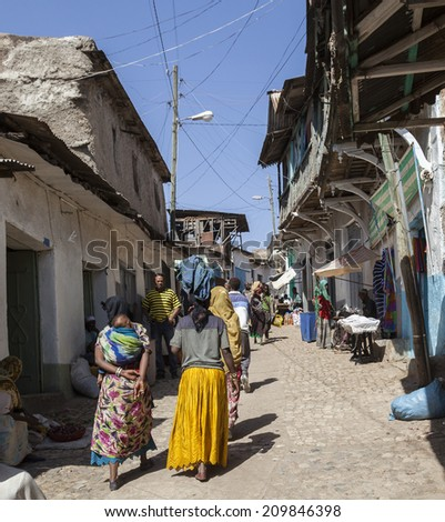 HARAR, ETHIOPIA - DECEMBER 24, 2013: Unidentified people of ancient walled city of Jugol in their daily routine activities that almost unchanged in more than four hundred years.