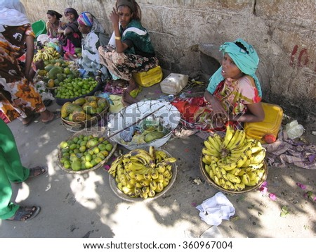 HARAR, ETHIOPIA - MARCH 28: Unidentified women sell fruits on a street of Harar, Ethiopia, March 28, 2012. Harar is famous for its gardens and coffee plantations in the Eastern Ethiopia.