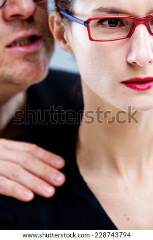 harassement of a woman by a man in an unhealhy workplace - stock photo