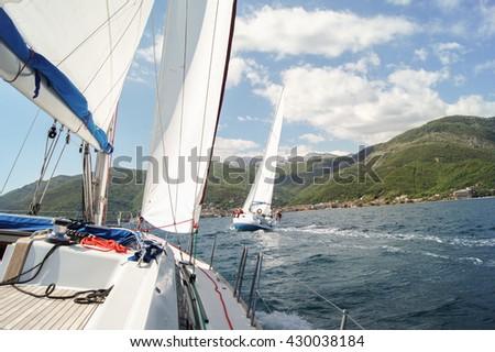 "Harassment opponent on a yacht. Tivat, Montenegro - 26 April, 2016. Regatta ""Russian stream"" in God-Katorskaya bay of the Adriatic Sea off the coast of Montenegro. - stock photo"
