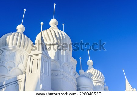 Harbin, China - January 11, 2015: Snow building. People are visiting. 27th China Harbin Sun Island International Snow Sculpture Art Expo. Located in Harbin City, Heilongjiang, China.