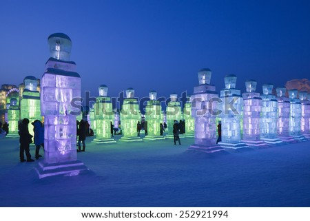 HARBIN-FEBRUARY 13, 2015. The 31st Harbin International Ice and Snow Sculpture Festival. It's best seen at night when ice sculptures are lit up from the inside, giving the whole area a fairyland feel. - stock photo