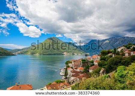 Harbor and ancient buildings in sunny day at Boka Kotor bay (Boka Kotorska), Montenegro, Europe.  - stock photo