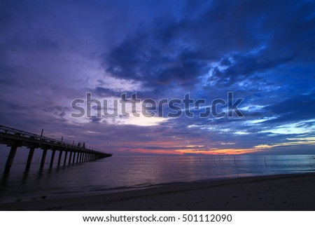 Harbor and Sea view on morning time before sunrise with silhouette fishing pier on foreground